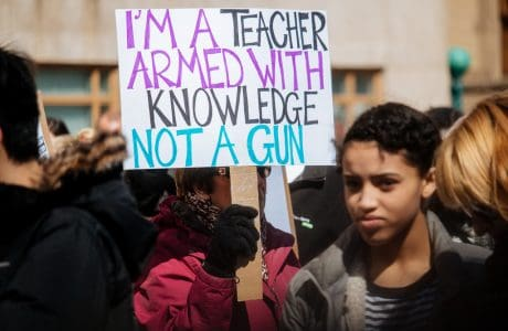 Teacher with Protest Sign